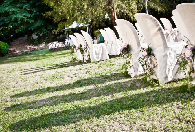 Wedding in Tuscany. Symbolic ceremony in the garden
